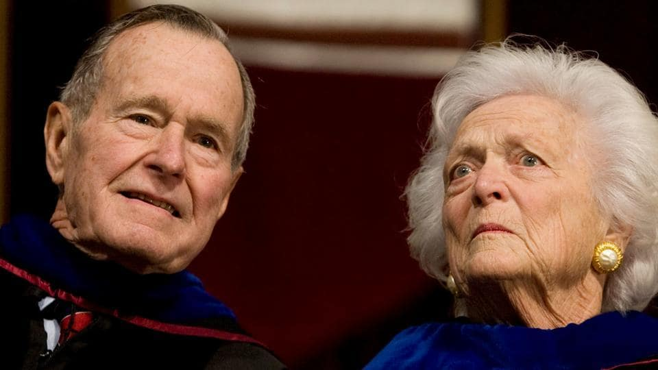Former President George HW Bush (L), and former first lady Barbara Bush attend the Texas A&M University commencement ceremony in College Station, Texas, December 12, 2008.