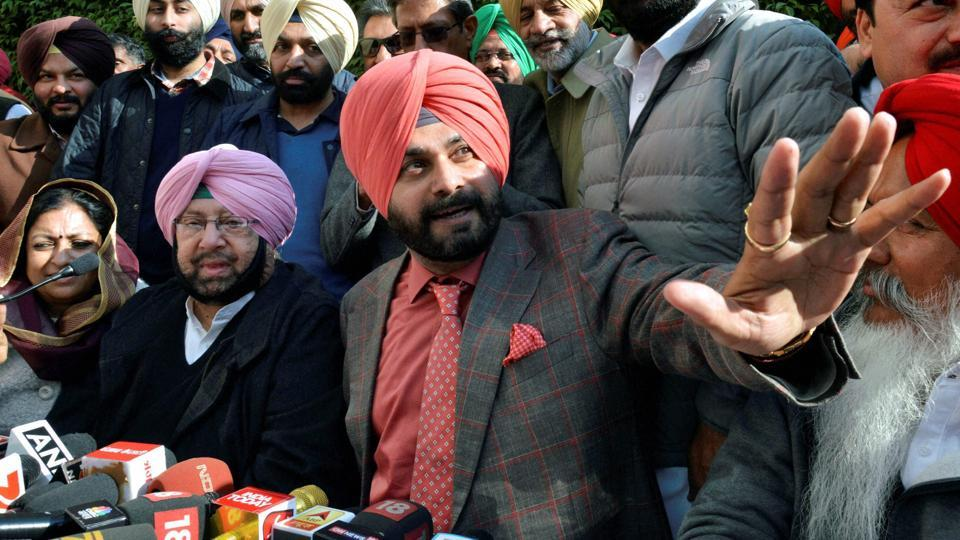 Punjab Pradesh Congress Committee president Amarinder Singh and Congress candidate and a former BJP MP Navjot Singh Sidhu during a joint press conference in Amritsar on Thursday.