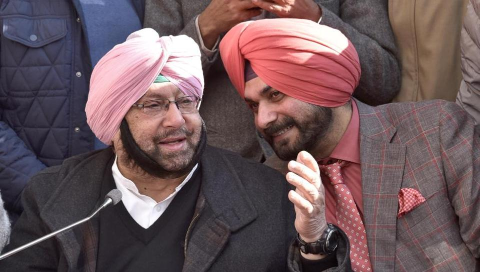 Punjab Pradesh Congress committee chief Captain Amarinder addressing media along with Navjot Singh Sidhu in Amritsar on Thursday.