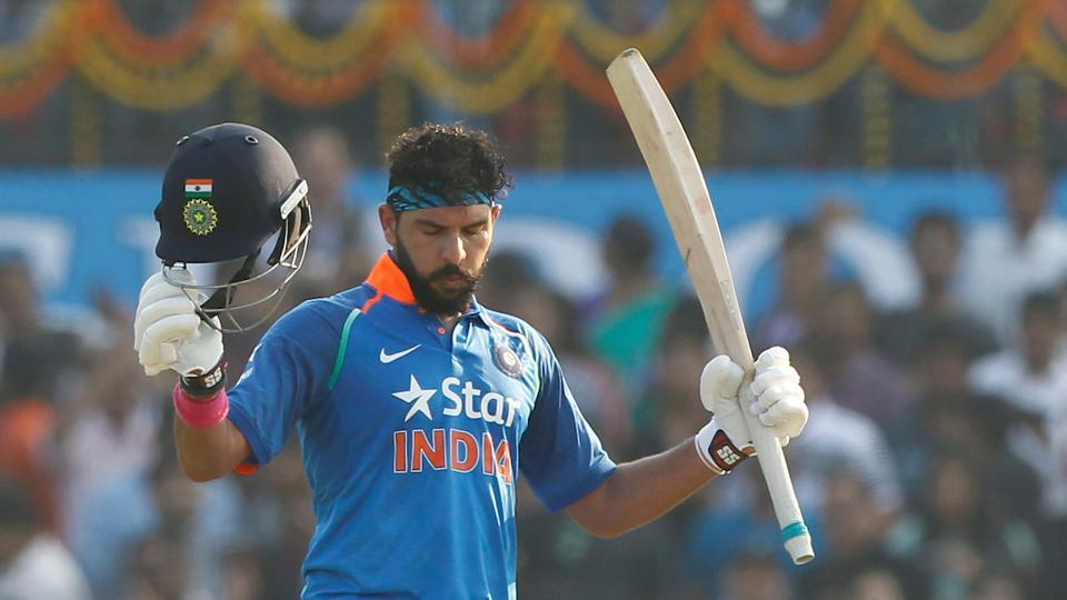Yuvraj Singh celebrates his century in the second One-Day International against England in Cuttack on Thursday.