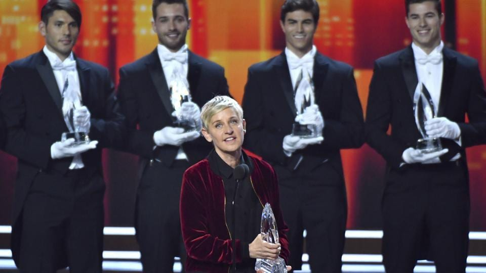 Ellen DeGeneres, winner of the awards for favourite animated movie voice, favourite daytime TV host, and favourite comedic collaboration, speaks on stage at the People's Choice Awards at the Microsoft Theatre in Los Angeles. Pictured in the background are DeGeneres' previous People's Choice awards, making her the most decorated People's Choice Award winner in the show's history.  (AP)