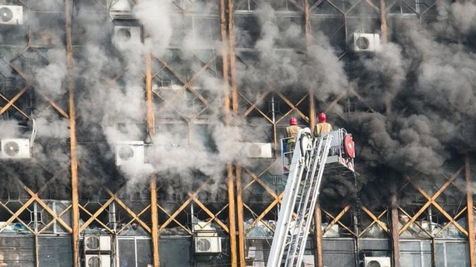 Firefighters try to put out fire in a blazing high-rise building in Tehran, Iran on Thursday.