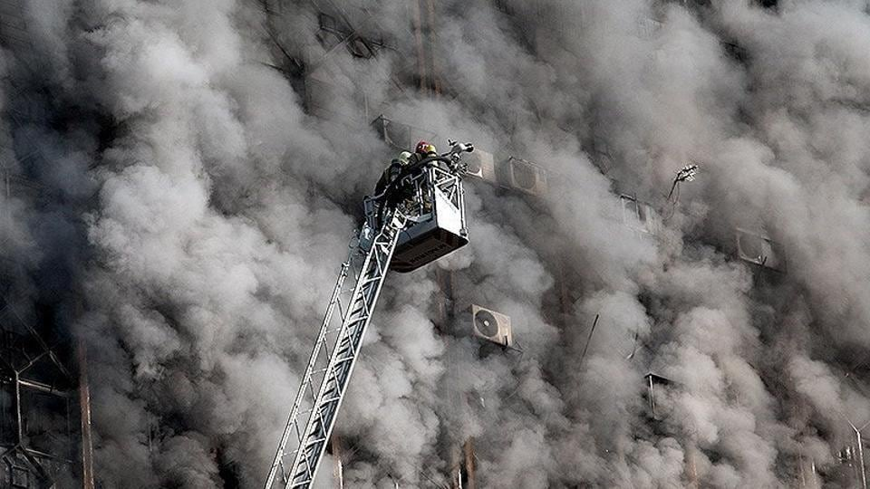 The fire is thought to have begun on the ninth floor and spread quickly to workshops above. (REUTERS)