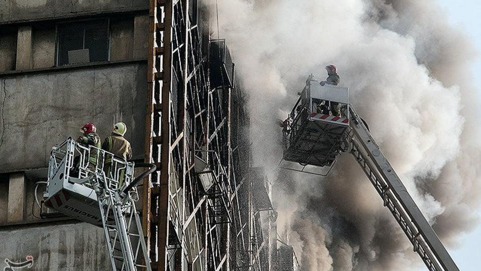 Firefighters try to put out the fire. Officials had yet to confirm if anyone had been killed, but the head of Tehran's emergency services told state TV that at least 70 people had been injured and 23 hospitalised before and after the building fell. (REUTERS)
