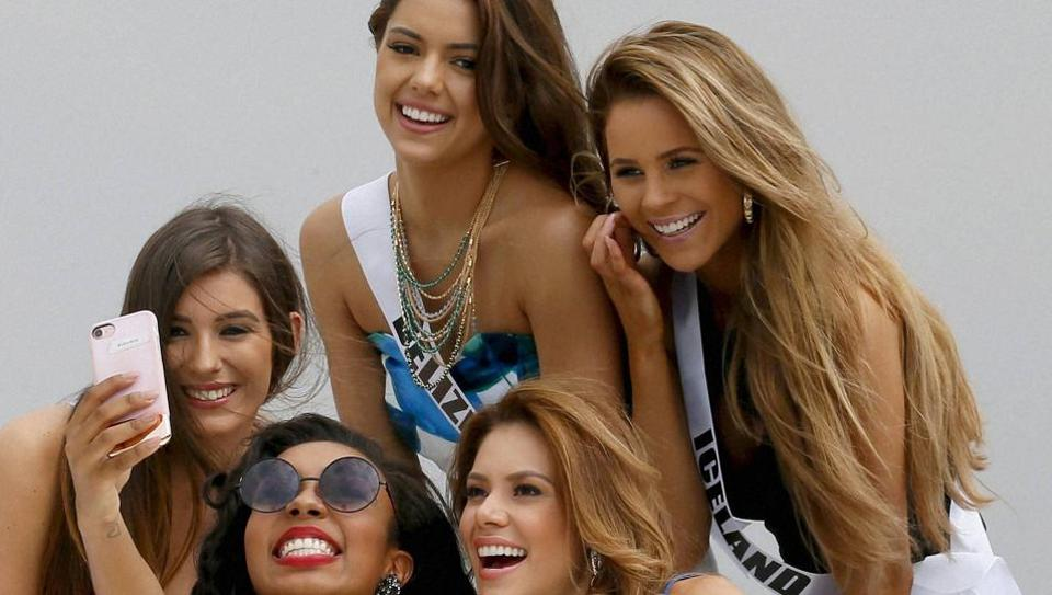 Miss Universe contestants take a selfie aboard the yacht Happy Life prior to cruising to a beach resort in Batangas province in Philippines.  (AP)