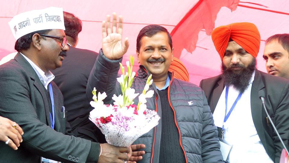 Delhi chief minister Arvind Kejriwal waves to the crowd during his visit to Ludhiana District Courts in Ludhiana on Wednesday, January 18,.