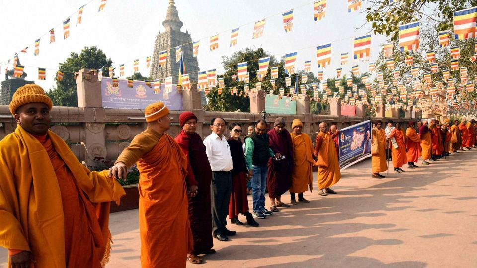 "Buddhist monks create human chain to promote liquor prohibition in Bodh Gaya on Thursday. Bihar government told Patna high court that participation in human chain programme is voluntary and ""there is no mandatory order for participation""."