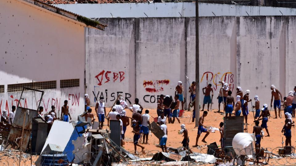 Inmates are seen during an uprising at Alcacuz prison in Natal, Rio Grande do Norte state, Brazil, on Thursday.