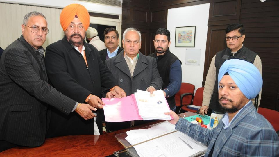 Congress candidate from Adampur segment Mohinder Singh Kaypee (third from left) filing nomination papers in Jalandhar on Wednesday.