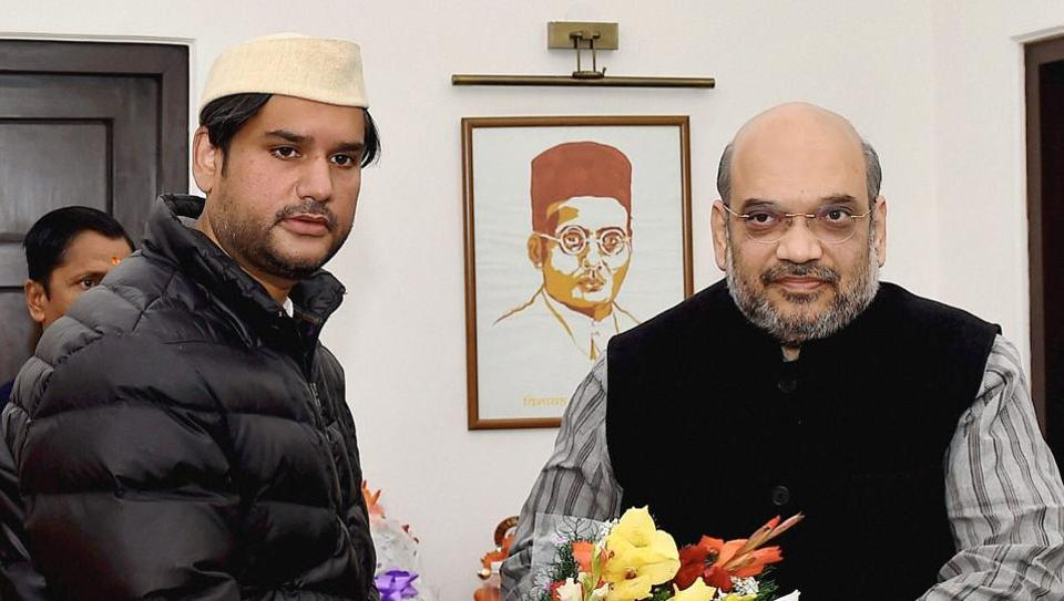 BJP national oresident Amit Shah greets Rohit Shekhar, son of former Uttarakhand and Uttar Pradesh chief minister and senior Congress leader, Narayan Dutt Tiwari, as he joins the Bharatiya Janata Party (BJP) in New Delhi on Wednesday.