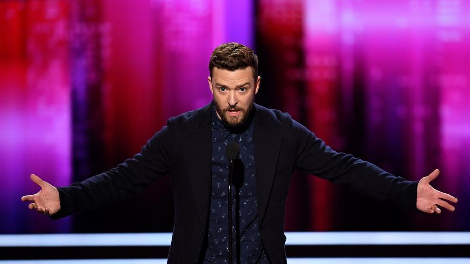 Singer/actor Justin Timberlake accepts Favourite Male Singer and Favourite Song for Can't Stop the Feeling! onstage during the People's Choice Awards 2017. (AFP)