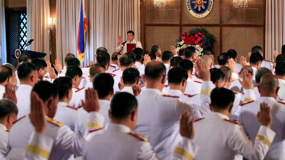 President Rodrigo Duterte (centre) leads the oath-taking of newly promoted officials of the Philippine National Police (PNP) at the Malacanang presidential palace in Manila on January 19, 2017.