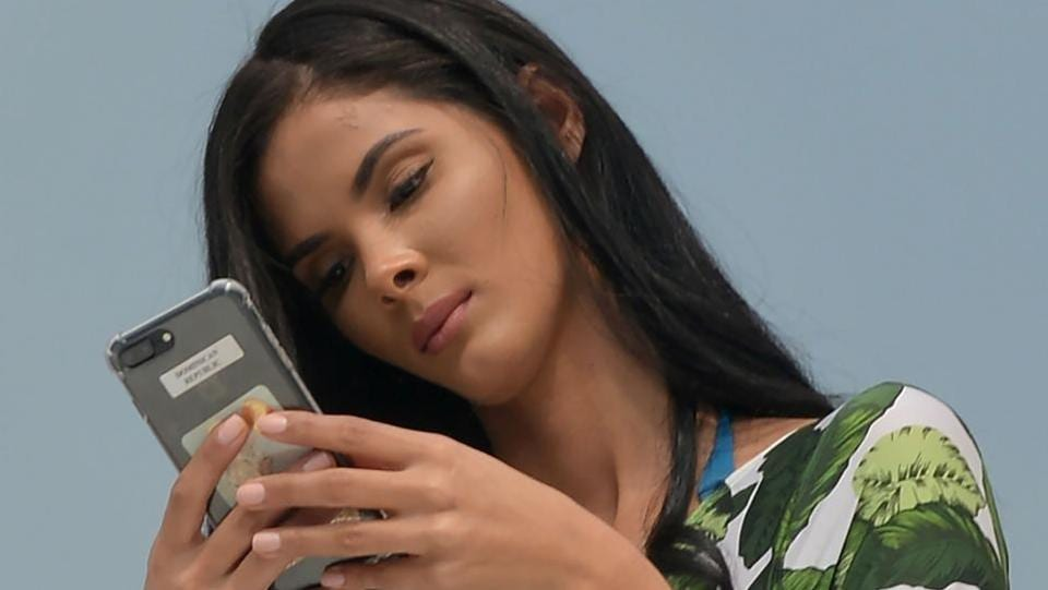 Miss Universe contestant Rosalba Abreu of Dominican Republic checks her smartphone. (AFP)