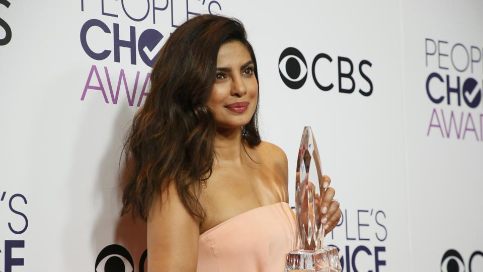 Priyanka Chopra holds the award for Favorite Dramatic TV Actress backstage at the People's Choice Awards 2017.