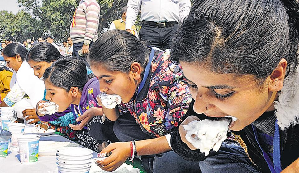 Participants at the Dahi Khao Inaam Pao (curd eating) contest in Patna.