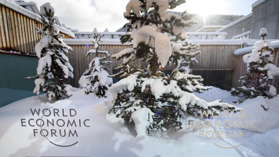 A WEF logo is pictured on a window of the Congress Center in front of snow covered trees ahead of the 47th annual meeting of the World Economic Forum, WEF, in Davos, Switzerland, Monday, Jan 16.