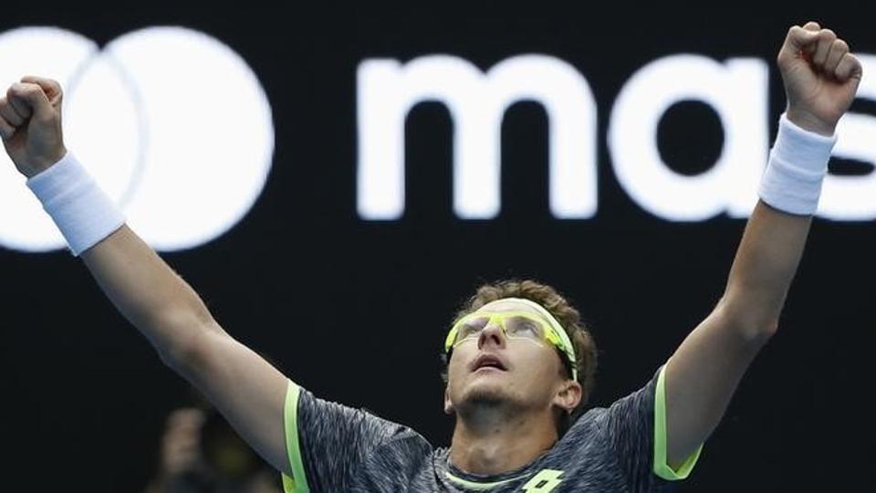 Denis Istomin celebrates after beating Serbia's Novak Djokovic at the Australian Open on Thursday.