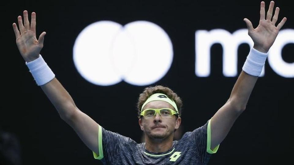 Denis Istomin celebrates after winning his match against Serbia's Novak Djokovic. (reuters)