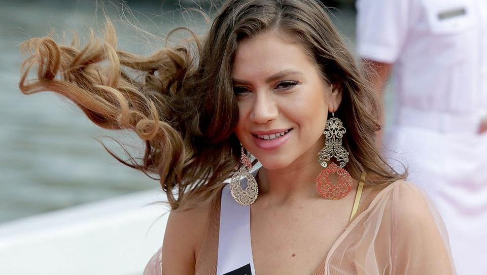Miss Romania Teodora Dan smiles as her hair gets swept in a strong gust of wind.