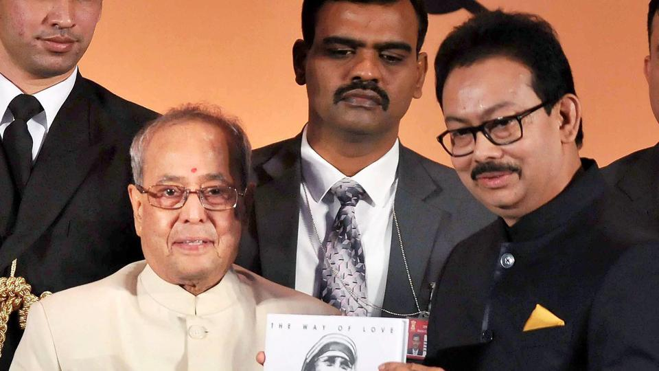 President Pranab Mukherjee receives a book on Saint Mother Teresa from Satyam Roychowdhury (R), chairman of Aajkaal Newspaper, during the inauguration ceremony of the 35th anniversary celebrations of the Bangla daily in Kolkata on Thursday evening.