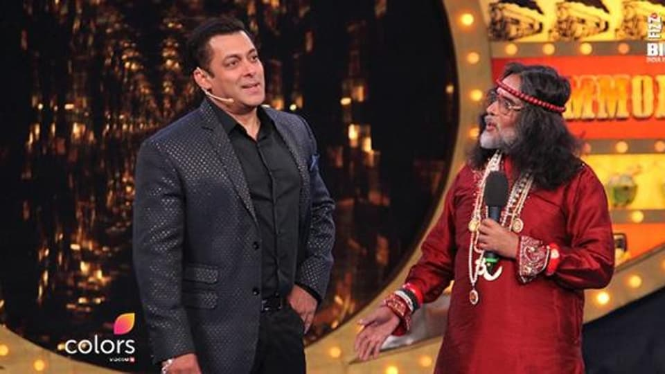Salman Khan shares the stage with om Swami during the show's opening.