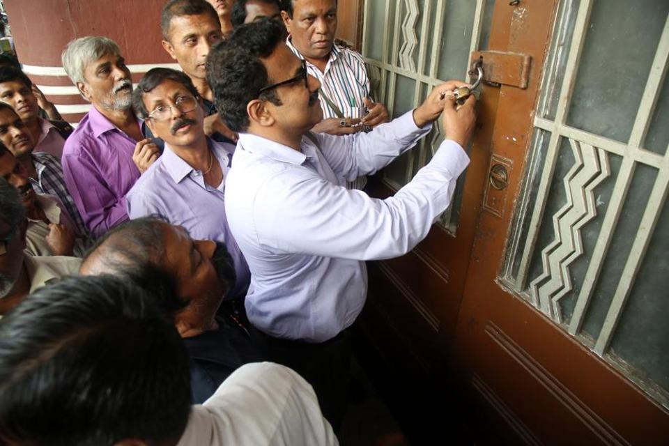Officials from the collector's office unseal Eros talkies cinema located in the Cambata building on Thursday
