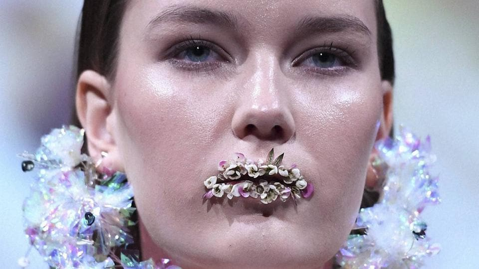 A model shows a creation of the label Livescape Bloom, during the presentation of the Fall/Winter 2017/2018 collection druing Berlin Fashion'Week in Berlin on Wednesday. (AP)