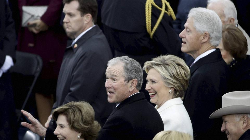 Former President George W Bush, left, his wife Laura, former secretary of state Hillary Clinton and former President Bill Clinton wait for the 58th Presidential Inauguration of Donald Trump. (AP)