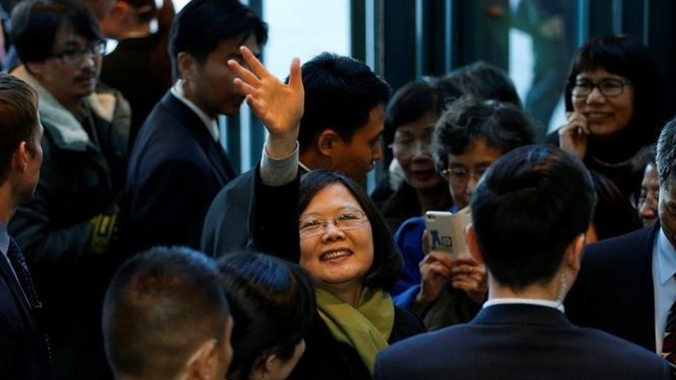 Taiwan President Tsai Ing-wen waves to supporters as she leaves a hotel for her return to Taiwan after her visit to Latin America in Burlingame, California, US.
