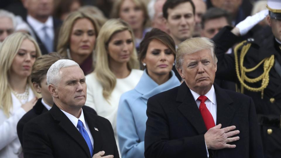 US President Donald Trump (R) and vice president Mike Pence stand for the singing of the US national anthem during their inauguration ceremony at the US Capitol in Washington. (REUTERS)