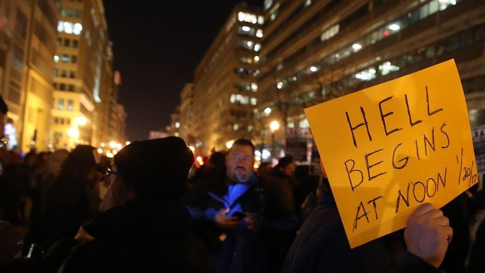 Anti-Trump protesters gather outside of the Deplora Ball at the National Press Building, on January 19, 2017 in Washington, DC.
