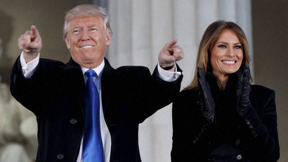 US President-elect Donald Trump, left, and his wife Melania Trump arrive to the 'Make America Great Again Welcome Concert' at the Lincoln Memorial in Washington.