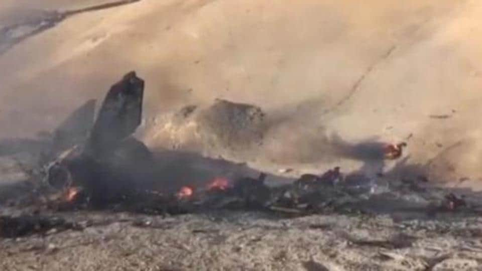 A still image taken on July 14, 2016 from a video posted on social media shows the wreckage of a Syrian jet that was brought down by Islamic State fighters near the eastern city of Deir al-Zor Syria.