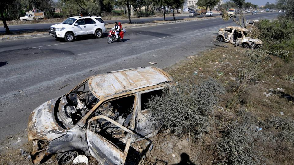 Damaged cars on national highway 1, at Murthal town nearSonipat in Haryana on February 23, 2016.