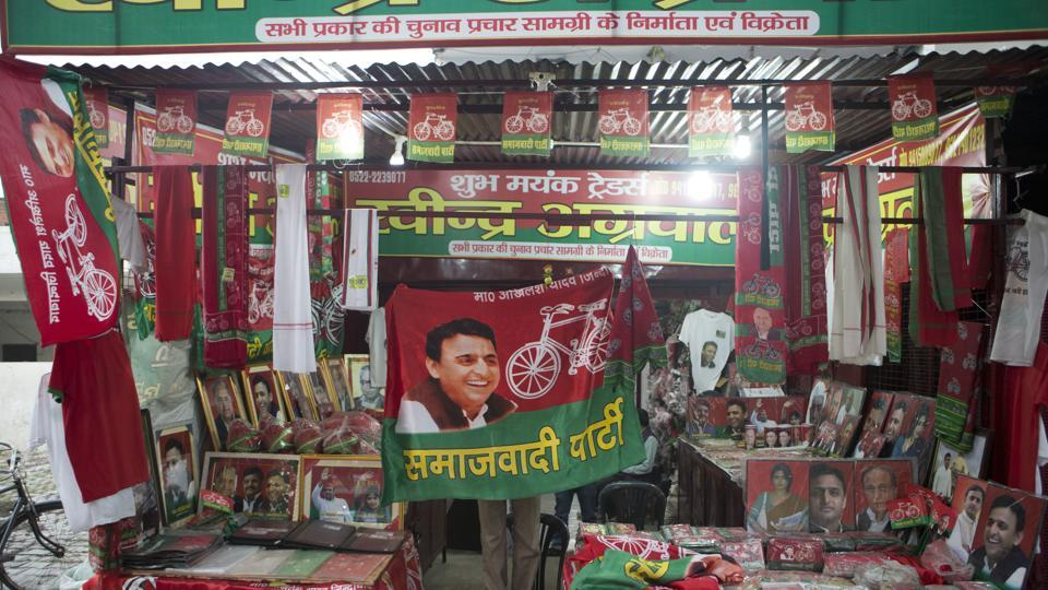 Samajwadi Party election campaign materials being sold at a stall near its party office in Lucknow. The party released its third list of candidates in Lucknow on Friday.