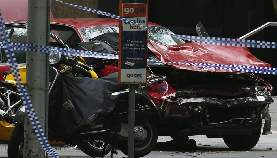 The wreckage of a car is seen as police cordoned off Bourke Street mall, after a car hit pedestrians in central Melbourne, Australia, January 20, 2017.
