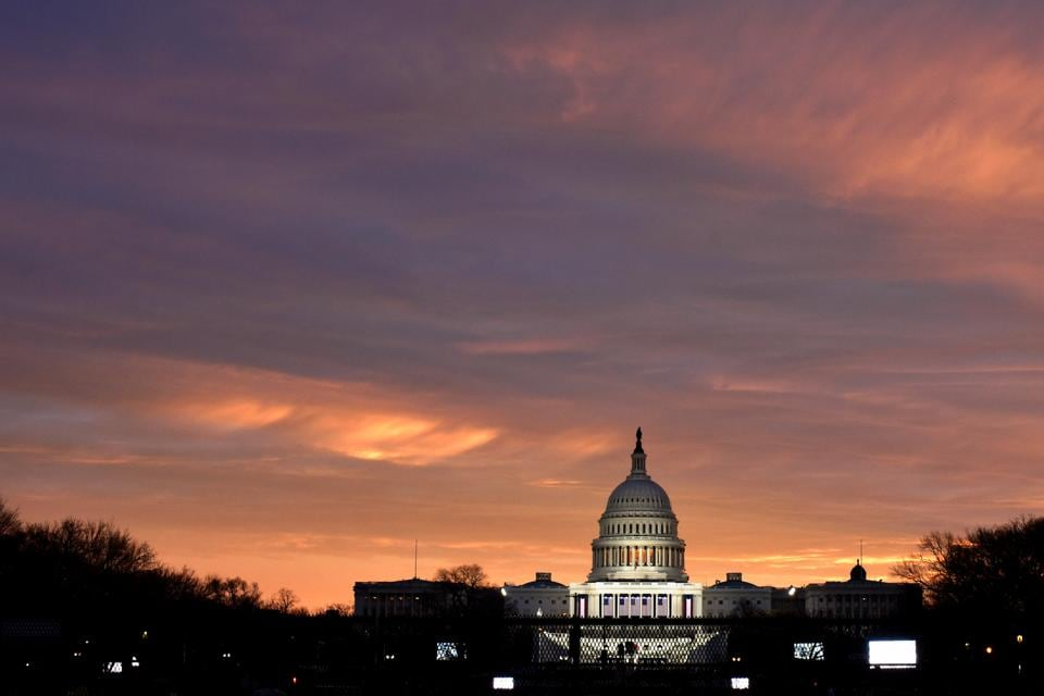The sun rises over the US Capitol on the National Mall on January 20, the day President-elect Donald Trump is sworn in in Washington, US. (REUTERS)