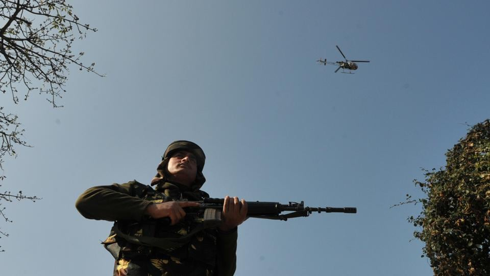 An army helicopter hovers outside a camp in the frontier Battal area, about 105 kilometres from Jammu.