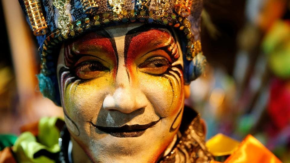 "A member of an Uruguayan carnival group participates in the inaugural parade of the Uruguayan Carnival in Montevideo. It has evolved into a dance parade in which different comparsas play the drums and dance to the music at ""Desfile Innaugural del Carnaval"" and Llamadas parade. (Andres Stapff / REUTERS)"