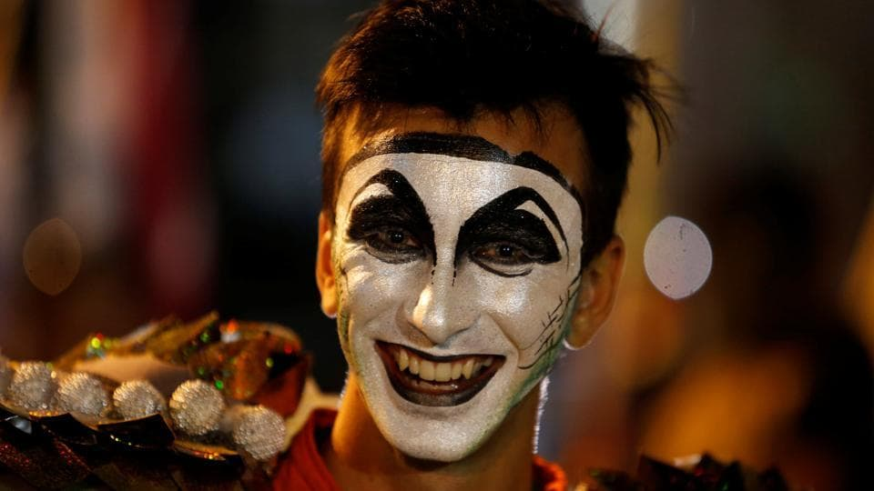 A member of an Uruguayan carnival group participates in the inaugural parade of the Uruguayan Carnival in Montevideo.  (Andres Stapff / REUTERS)