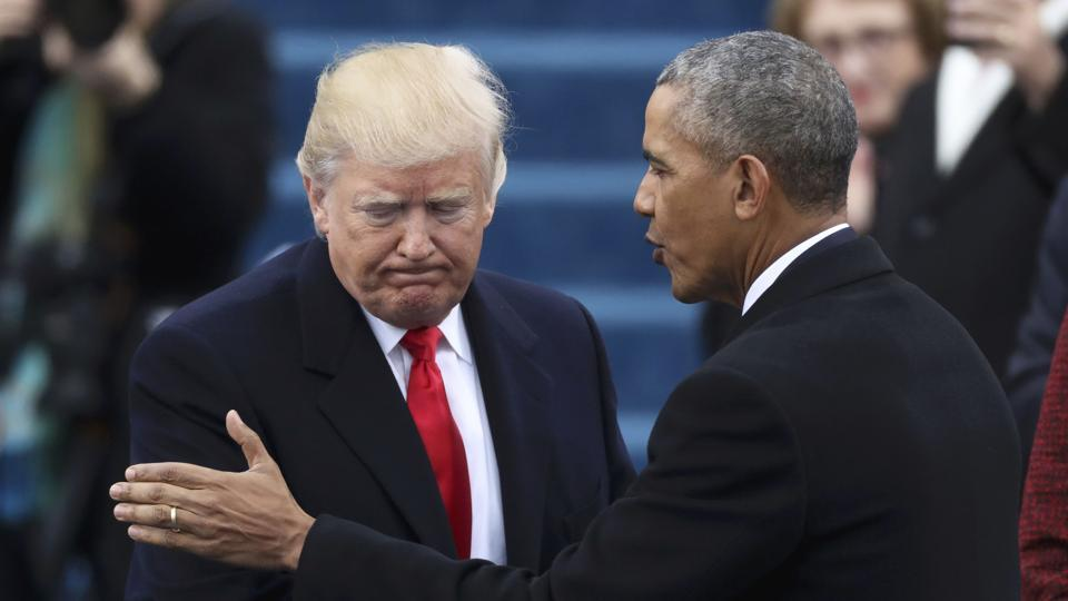 Barack Obama (R) greets Donald Trump at the inauguration ceremony. (REUTERS)