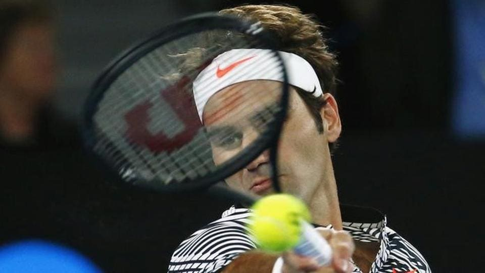 Switzerland's Roger Federer hits a shot for his Men's singles third round match against Czech Republic's Tomas Berdych. (REUTERS)