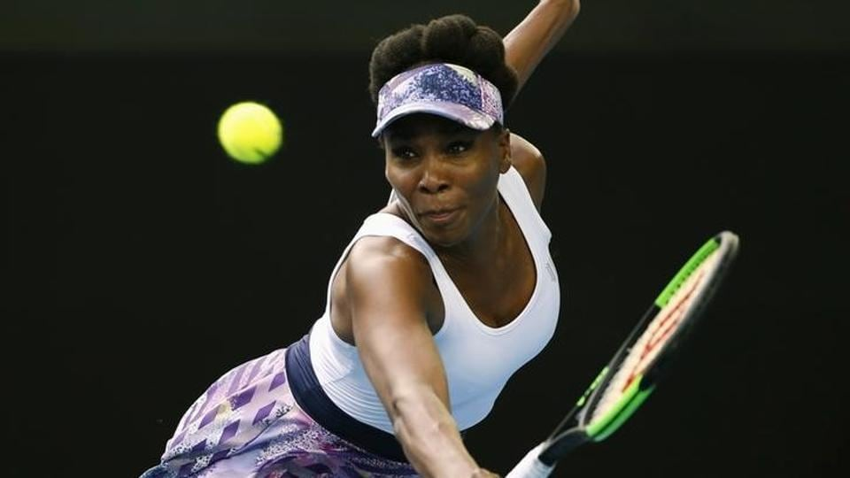 Venus Williams of the U.S hits a shot during her Women's singles third round match against China's Duan Ying-Ying. (REUTERS)