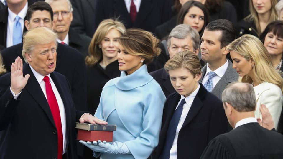 Donald Trump is sworn in as the 45th president of the United States by Chief Justice John Roberts as Melania Trump looks on during the 58th Presidential Inauguration at the US Capitol in Washington.