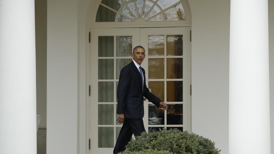 Barack Obama walks from the Oval Office of the White House in Washington, perhaps for the last time as President of United States, before the start of presidential inaugural festivities on Friday, (AP)