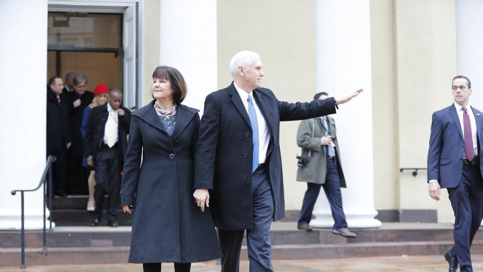 Vice-president-elect Mike Pence and his wife Karen leave a church service at St. John's Episcopal Church across from the White House in Washington, on Friday. (AP)