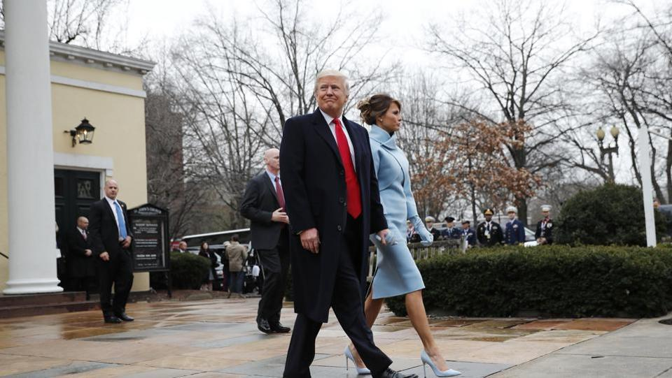 President-elect Donald Trump and his wife Melania leave a church service at St. John's Episcopal Church across from the White House in Washington on Friday.  (AP)