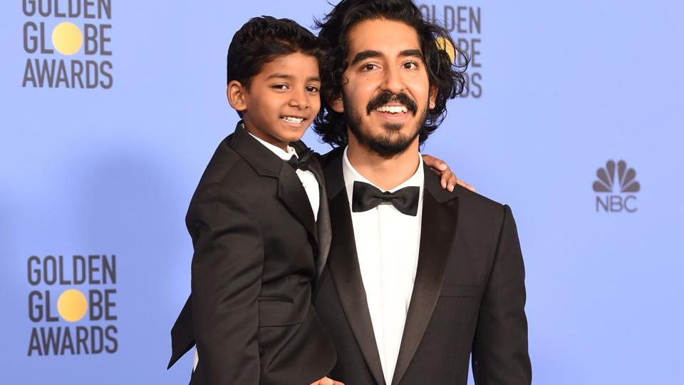 Actors Sunny Pawar (L) and Dev Patel pose in the press room at the 74th annual Golden Globe Awards.