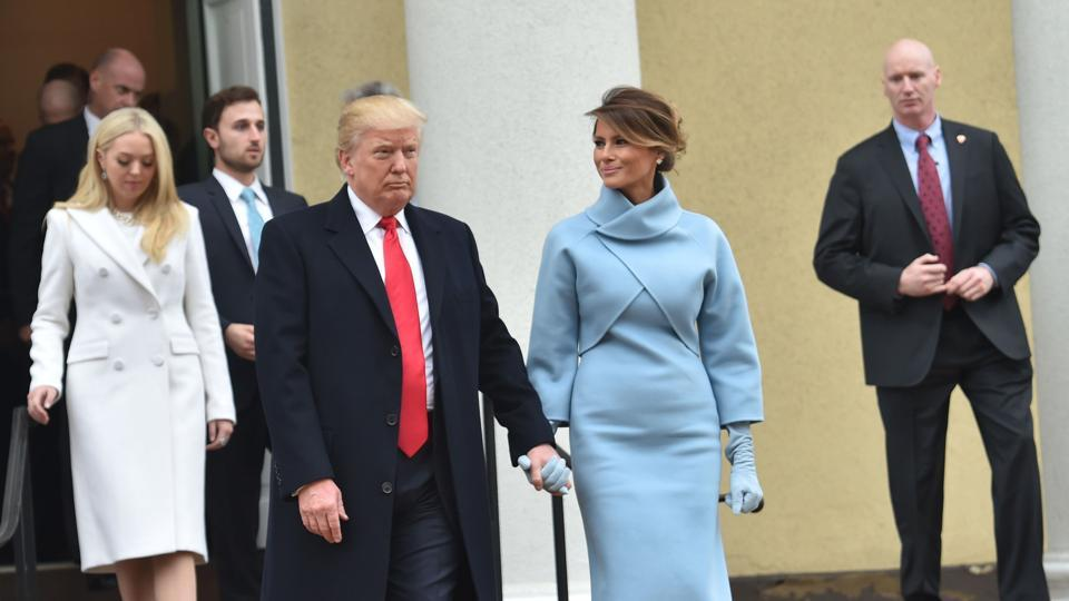 US President Donald Trump and his wife Melania leave St. John's Episcopal Church.