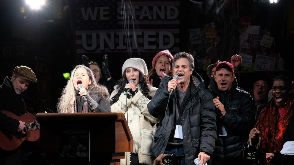 Natalie Merchant, Cher, and Mark Ruffalo sing onstage during the We Stand United NYC Rally outside Trump International Hotel & Tower on January 19.